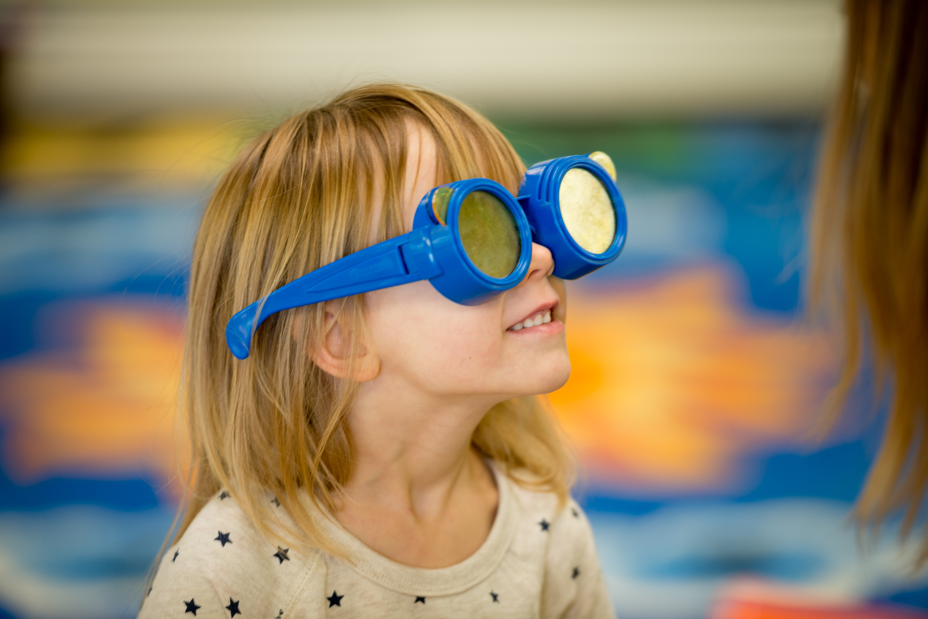 Our vision - young child gazing upwards wearing goggles