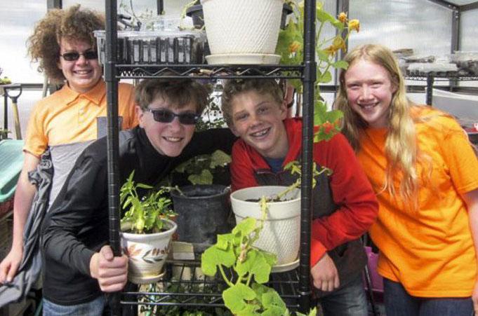 mackintosh academy students in greenhouse